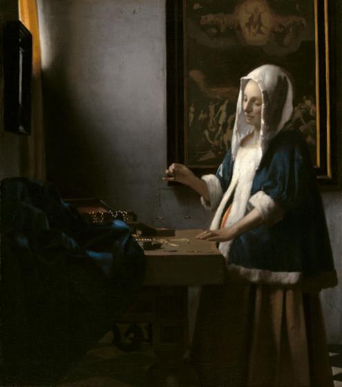Woman Holding a Balance – Johannes Vermeer
